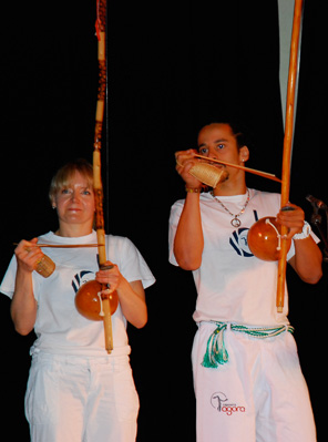 Estagiária Justyna and Professor Thiago playing the berimbaus during the performance in Camden, London, 2009